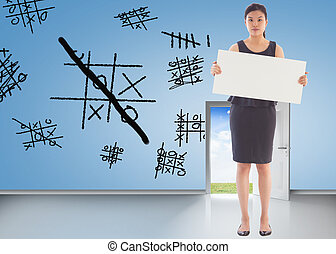 Composite image of businesswoman holding a placard -...