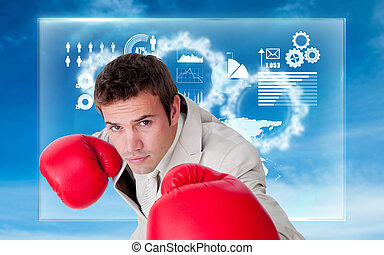 Composite image of confident businessman wearing boxing...