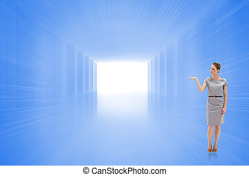 Composite image of woman in a dress holding her hand up -...