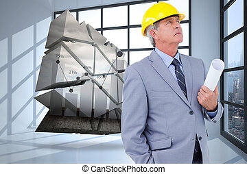 Composite image of mature architect taking a close look -...