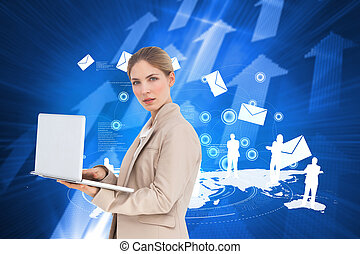 Composite image of businesswoman with a laptop -...