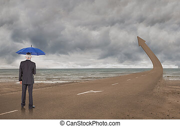 Composite image of businessman holding umbrella -...