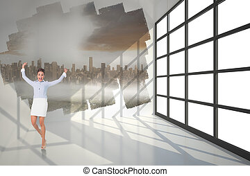 Excited brunette businesswoman jumping and cheering against...