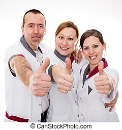 three nurses demonstrate teamwork and success in front of...