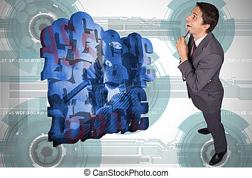 Composite image of thinking businessman holding pen -...