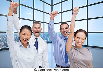 Composite image of cheerful work team posing with hands up -...