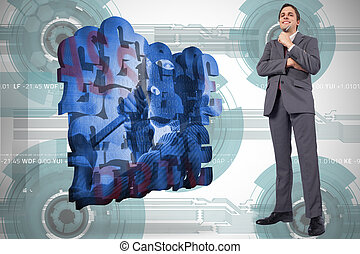 Composite image of thoughtful businessman holding pen to...