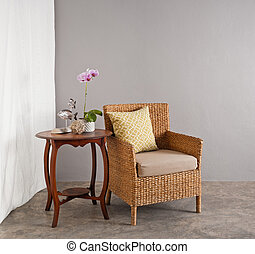 Rattan chair in lounge setting - Rattan chair in a patio...