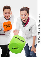 concept aging and assisted living - two female nurses...