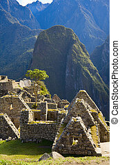 Houses of Machu Picchu - Ruins of stone houses at Machu...