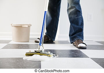 Mopping floor - Housecleaning chores - a person is mopping...