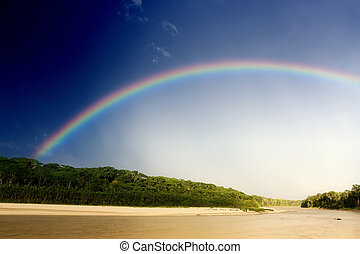 Rainbow over river - Manu River after the storm Manu...