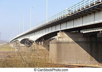 Pylons of highway bridge over river
