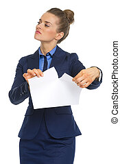 Displeased business woman tearing documents