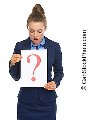 Surprised business woman looking on paper sheet with question mark