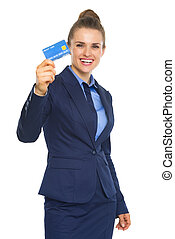 Smiling business woman showing credit card
