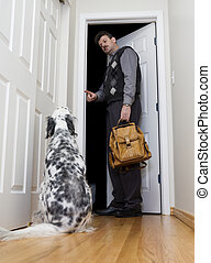 Be good now - A man leaving for work asks his dog to behave...