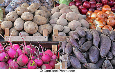 Root vegetables - Big pile of root vegetables on market...