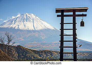 Fuji Mountain and an old village bell tower in Japan.