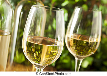 Refreshring White Wine in a Glass on a Background