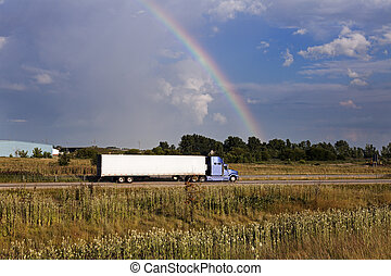 Semi truck driving under the rainbow - Chicago, Illinois