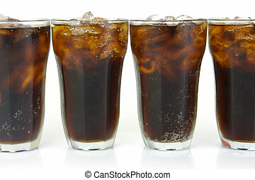 Cold Cola - Glasses of cola isolated against a white...