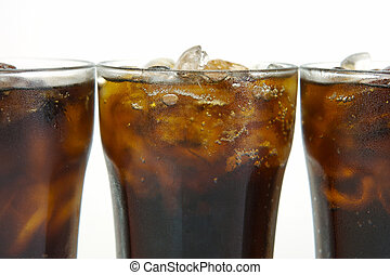 Cold Cola, Cold Cola - Glasses of cola isolated against a...
