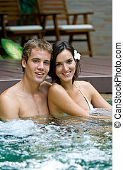 In Jacuzzi - A young attractive couple in a jacuzzi in...