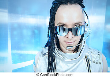 high technology - Eccentric futuristic man in silver costume...