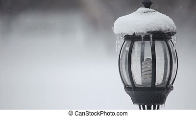Snowy lantern - Lantern covered with snow. Rack focus.