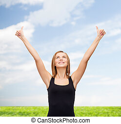 woman in blank black tank top showing thumbs up - t-shirt...