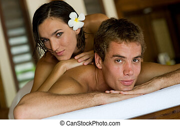 Couple At Spa - A young couple lying together at a spa