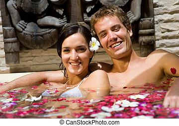 Couple In Bath - A young couple together in a bath with...