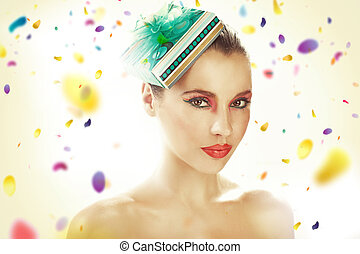 Young woman wearing gift-hat
