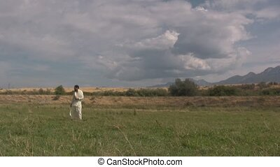 Arabian man standing in a field of clouds