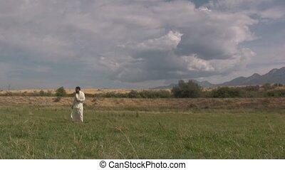 Arabian man standing in a field of