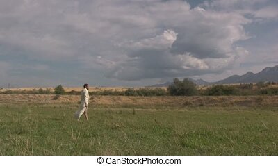 Arabian man standing in a field of grass