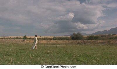 Arabian man standing in a field of grass