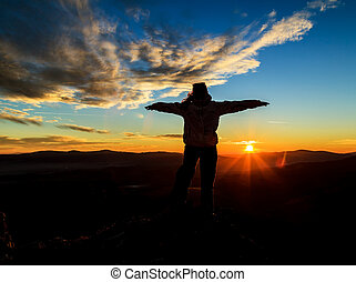 Silhouette photo and sunset on the top of mountains