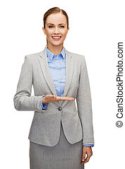 smiling businesswoman holding something imaginary -...