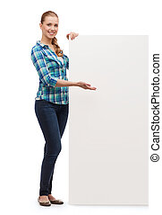 smiling young woman with white blank board - happiness,...