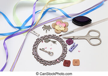 scrapbooking - scrapbook tools with decoration on white...