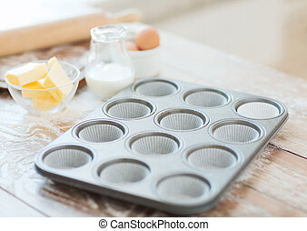 close up of empty muffins molds - cooking and home concept -...