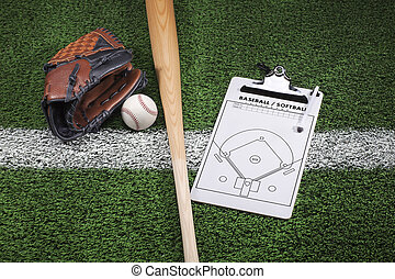 Baseball mitt, bat and clipboard on grass with stripe -...