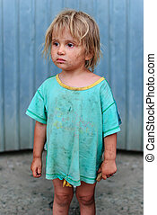 poor children - Frightened girl with a piece of bread in his...