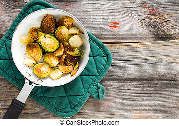 Sauteed brussels sprouts in a saucepan - Delicious browned...