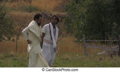 Arabian men standing in a field