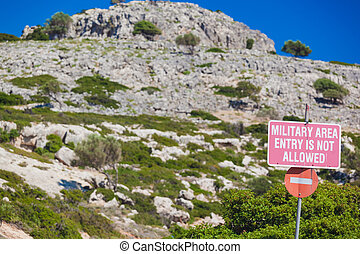 military area no entry sign on blue sky