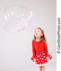 Little girl making the soap bubbles - Little cute girl...