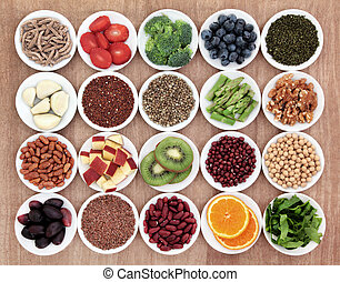Health Food - Superfood health food selection in white bowls...